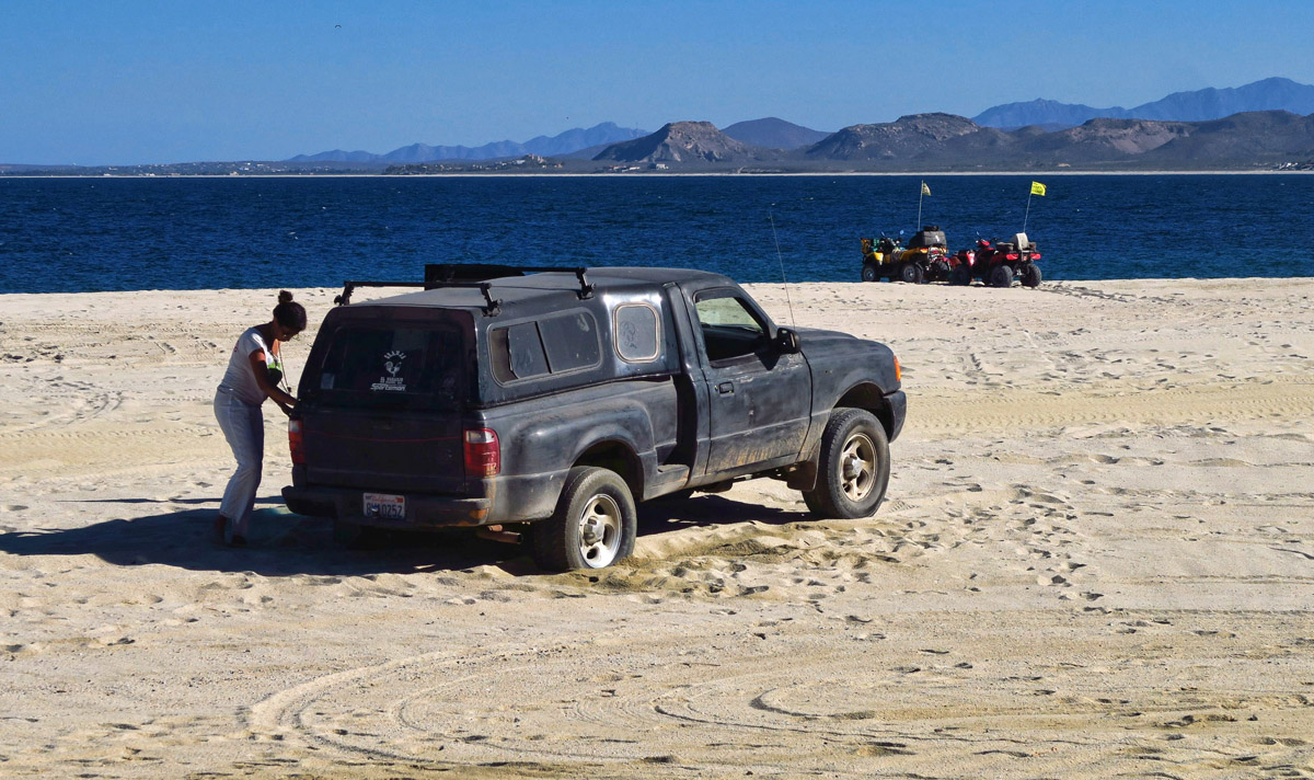 This poor woman was stuck in the sand. I tried to help, but finally some Mexican men came to her aid. But not until at least three gringos on ATVs passed her by.