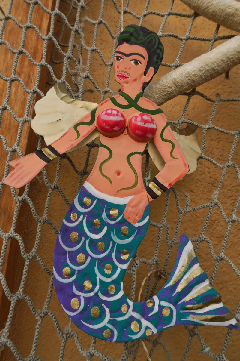 A very unflattering rendition of Frida as a mermaid? More like a transgender in progress.