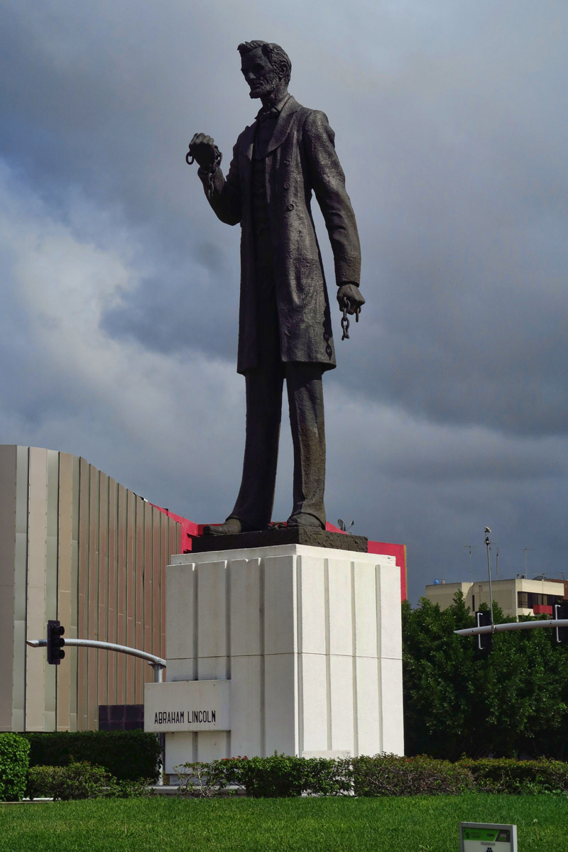 "Along Tijuana's ""Paseo de los Heros,"" one might be surprised to see a statue of Abraham Lincoln. Note the broken chains in his fists. Lincoln is honored by Mexico for his support against European occupation forces in the 1860s. He is honored with a statue as a friend to Mexico. What a concept!"