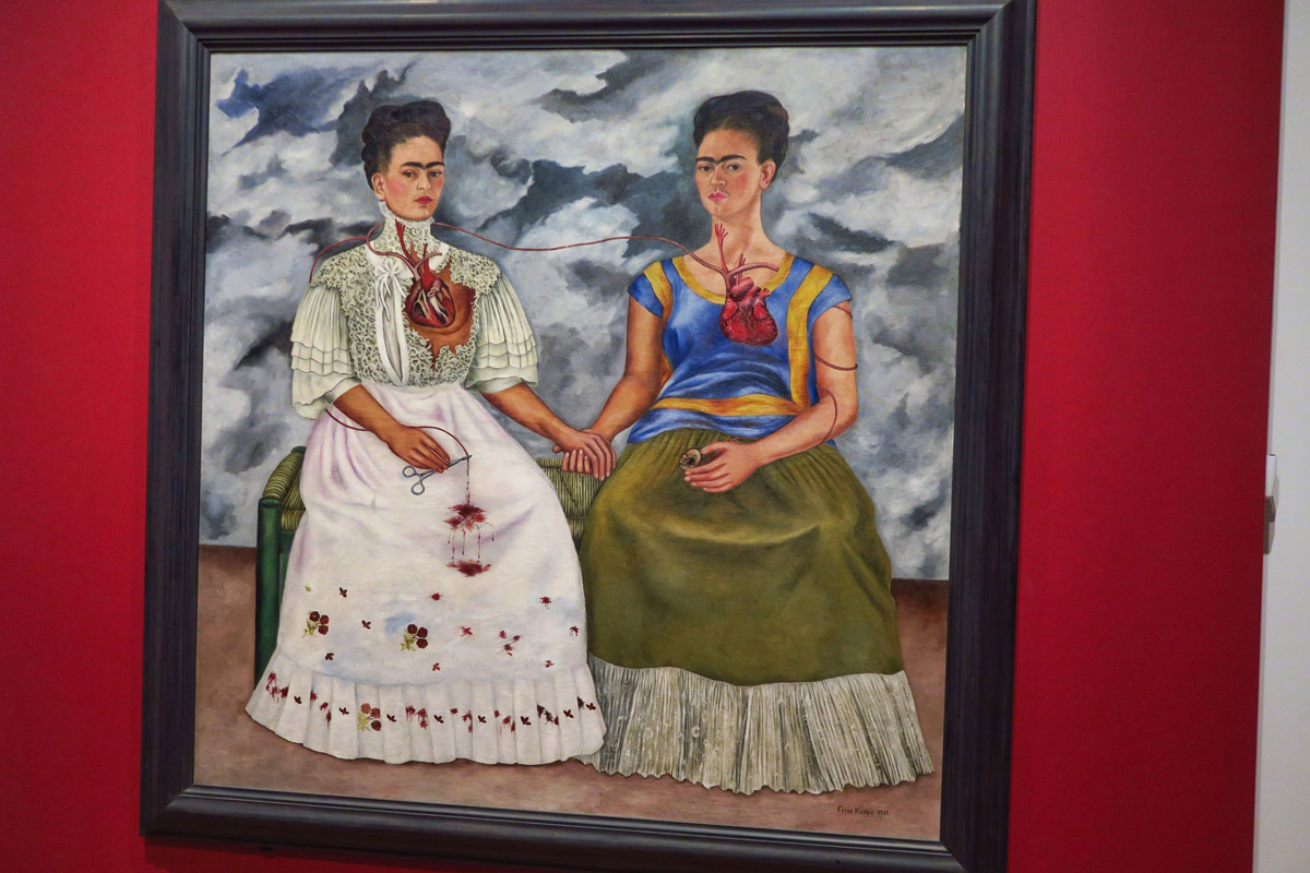 "Frida's largest painting, ""The Two Fridas,"" 1939, thought to represent the pain and disappointment from the divorce from her husband, Diego Rivera."