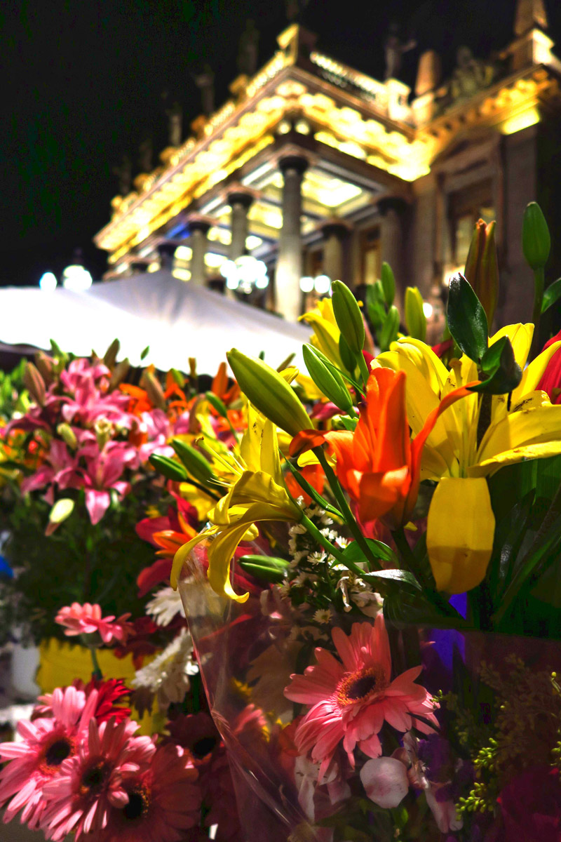 Night falls and the lights come up on Teatro Juarez, and the flower vendors don't sleep.