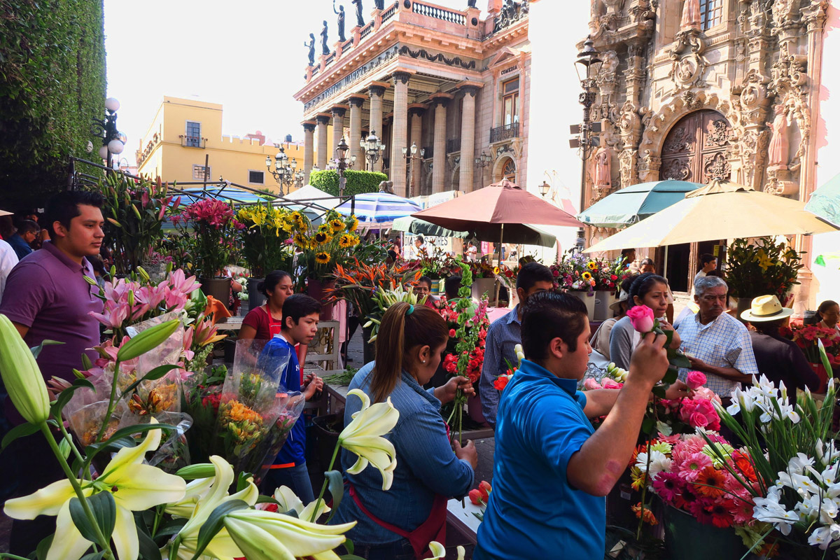 "Jardin de Union, the main triangular-shaped square becomes ""flower central"" as flower vendors line both sides of the streets."