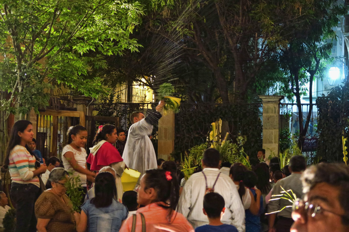 After the Palm Sunday mass, the Priest exits first, then sprinkles the masses with Holy Water as they exit the church.