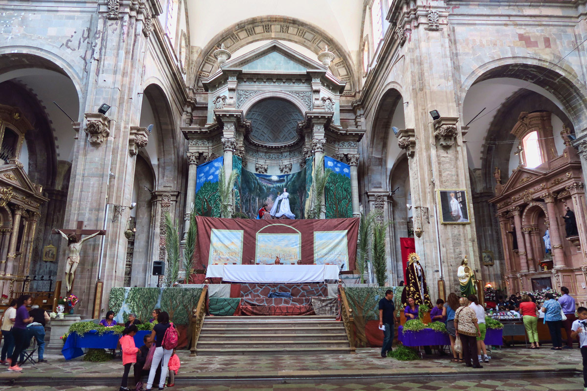 The larger church, has stations from the Passion Play set up all around the perimeter of the church. The main altar has been converted to a stage to act out the washing of the feet and the Last Supper.