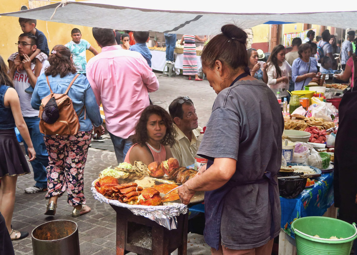 Food vendors also set up outside the churches. This woman is making Enchiladas Mineras, a Guanajuato specialty created to feed the miners. In addition to the usual enchilada ingredients, it also has potatoes and carrots.