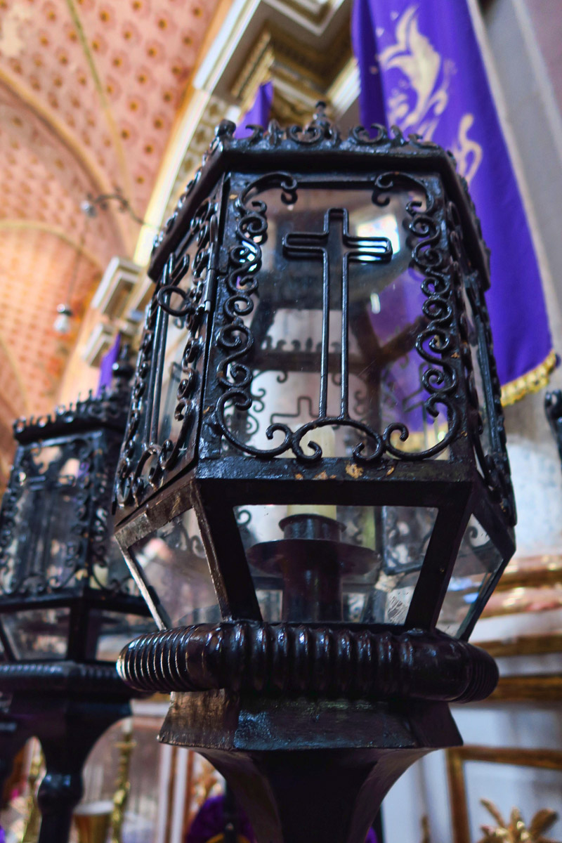 The church is filled with hundreds of these decorative lanterns containing candles. These will be used in the funeral procession.