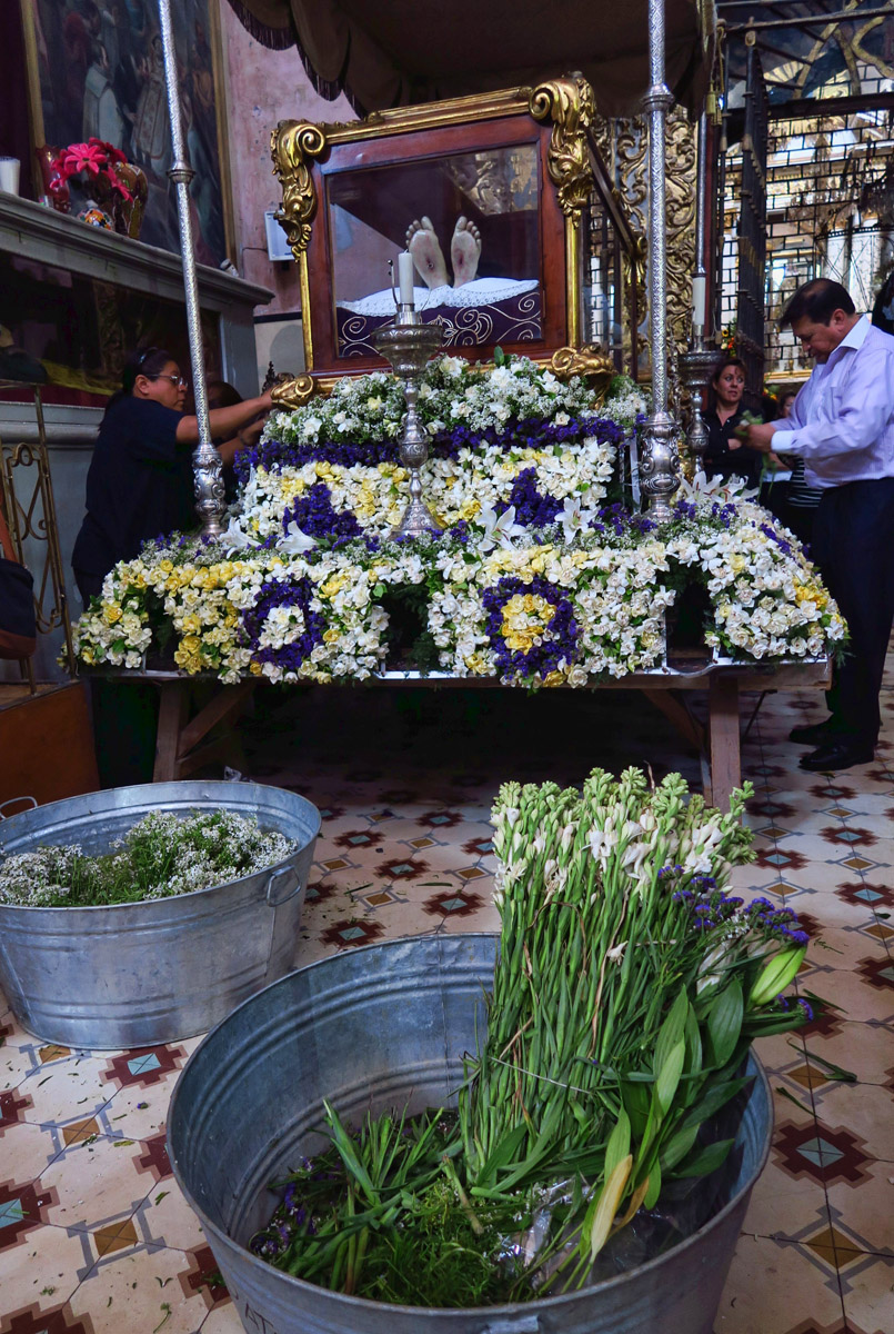 "Lots of activity inside the Oratorio as they prepare the ""human floats"" with flowers. This is a large glass coffin containing life-sized Jesus."