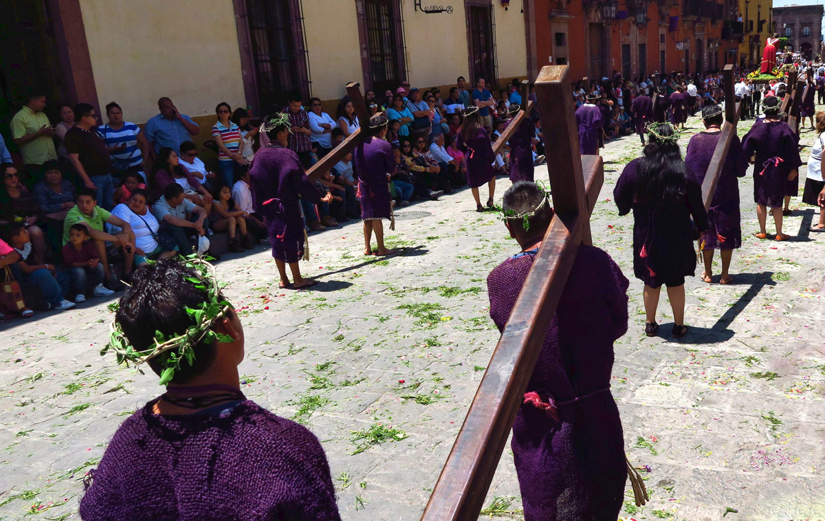 There are about twelve men and women carrying crosses. This is considered a great honor. Though it is 90 degrees, a few have chosen to walk barefoot.