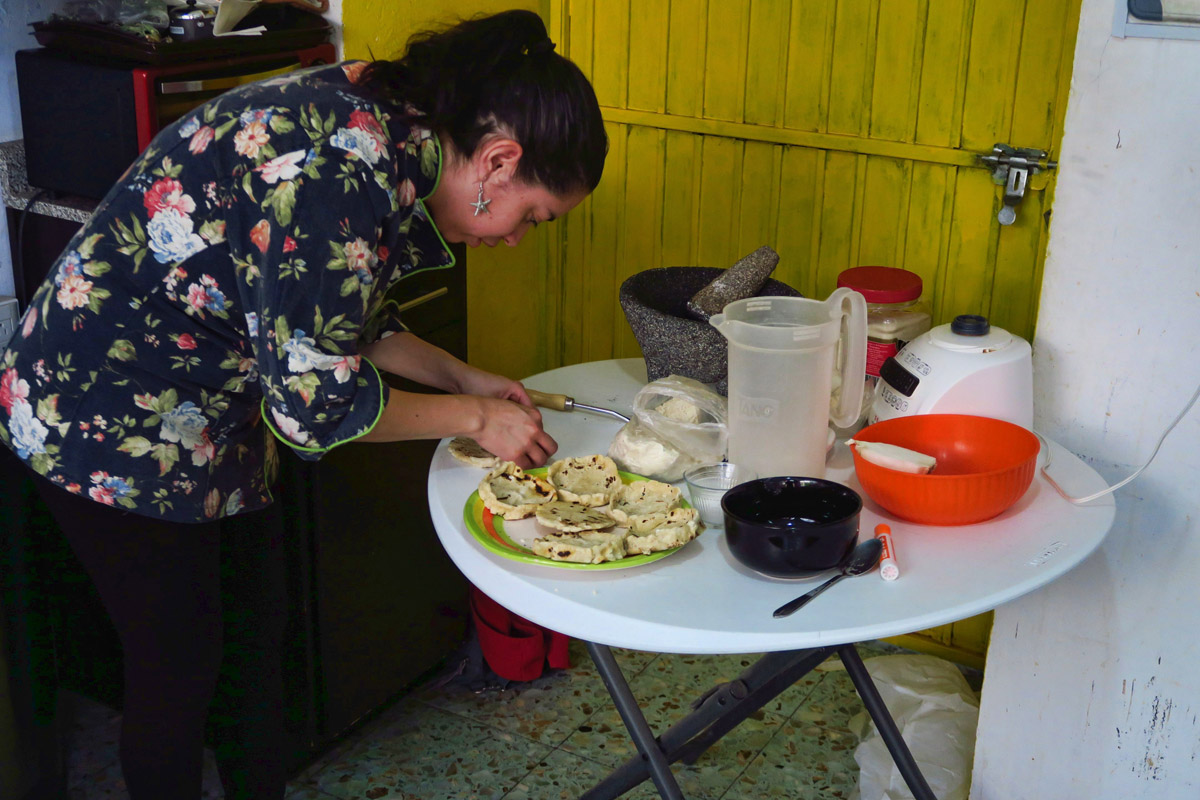 This is my instructor for cooking class. (mi maestra de clase de cochina) She is showing us how to make Sopes.