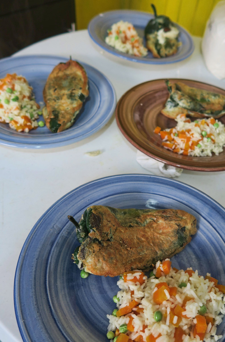 The finished product...Chile Relleno stuffed with cheese, and a side of vegetable rice.