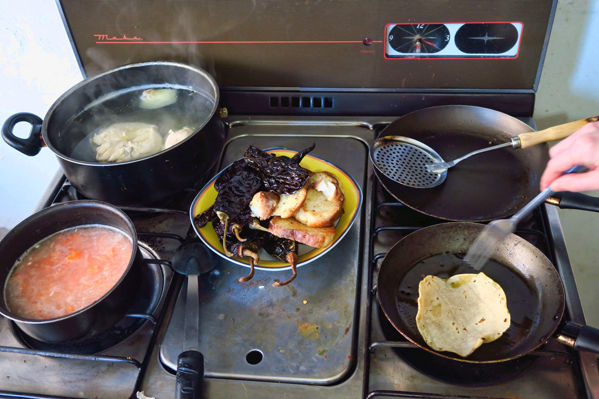 Chilies get roasted on open flame, bread and tortillas get toasted in lard.