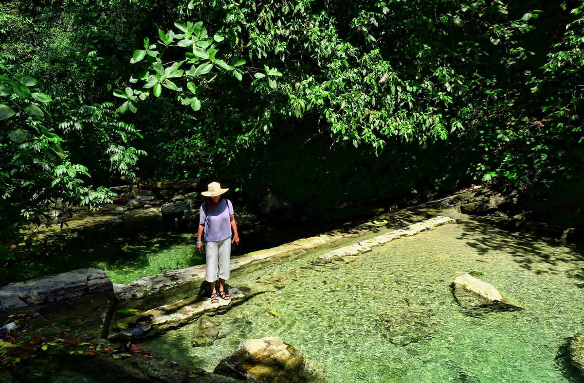 Vivian explores the pools, or cisterns that have collected from the cascading waterfalls.