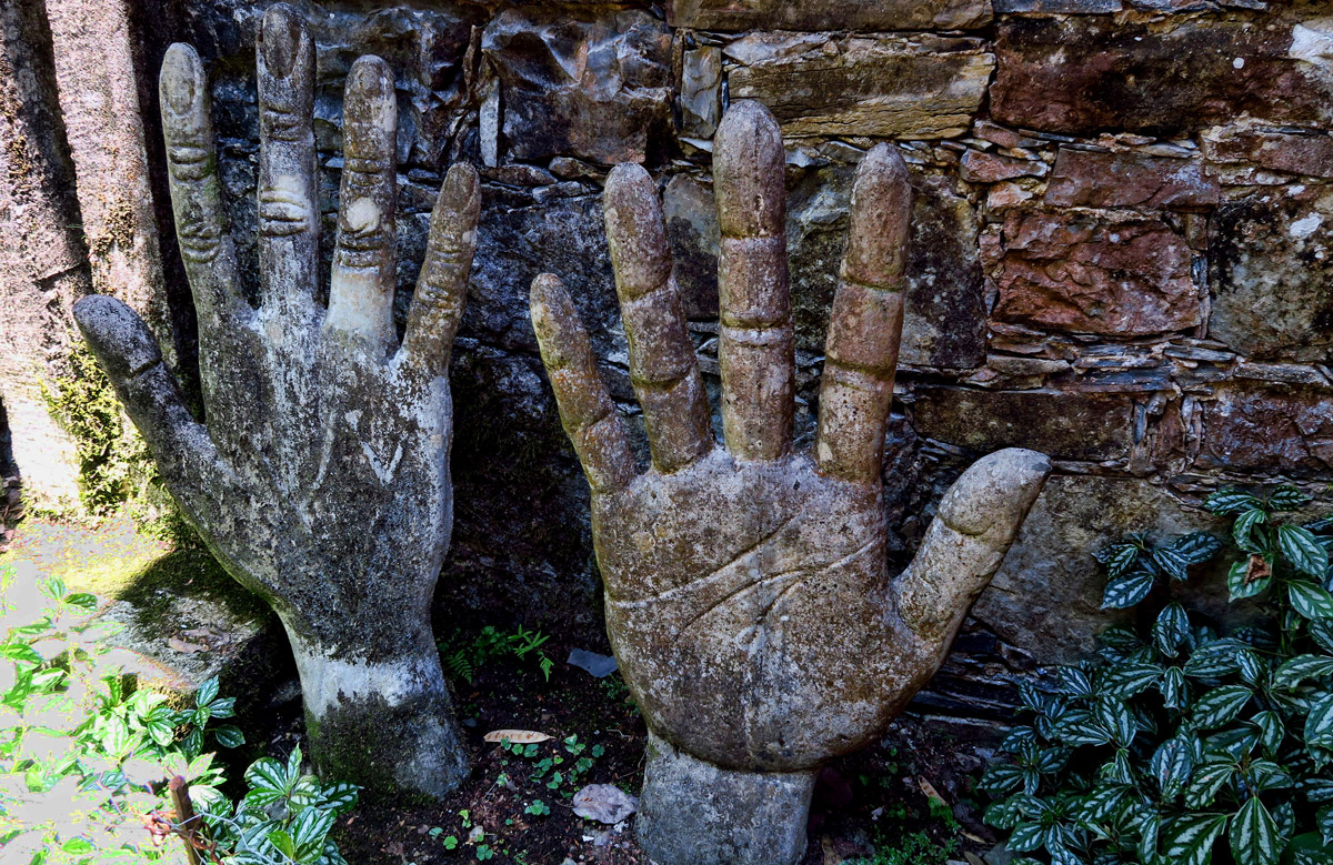 "These giant hands are reported to be cast in the shape of Plutarco Gastelum, James' guide and ""travel companion."""