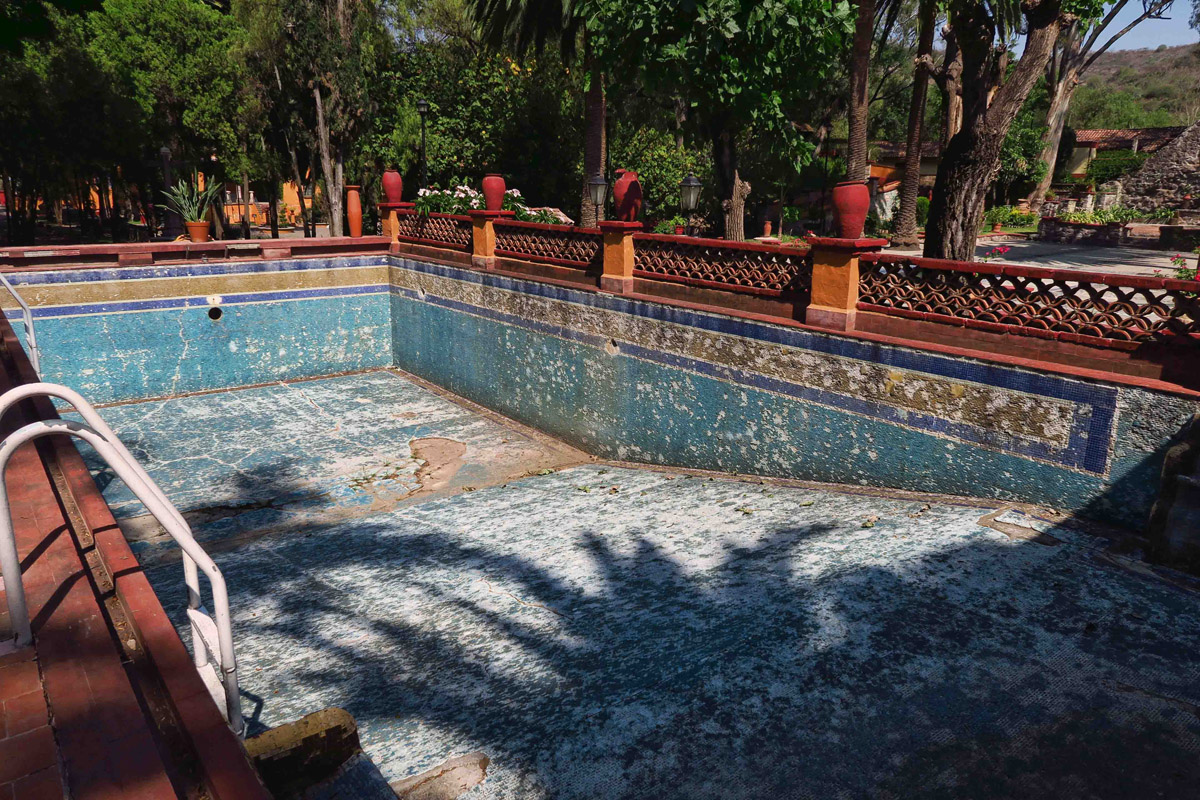 Sadly, this beautiful mosaic swimming pool, complete with underwater benches (outside of photo) has fallen in disrepair.
