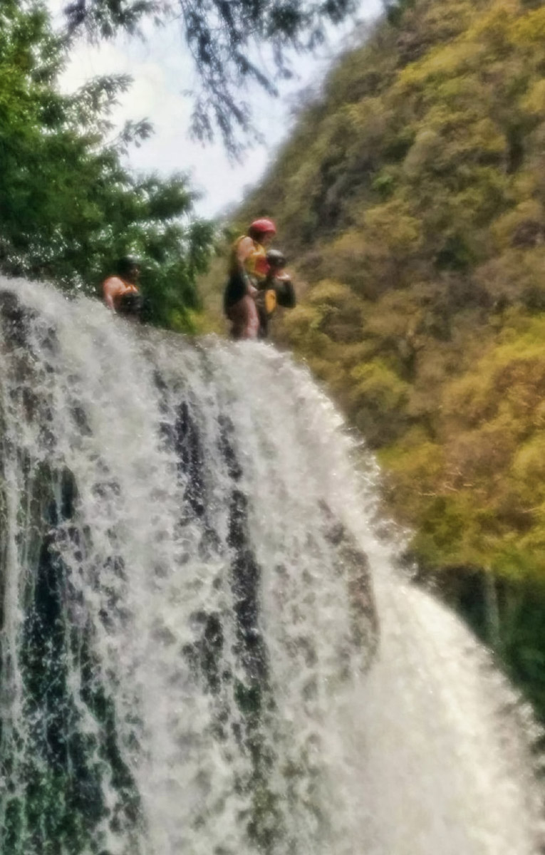 Vivian also snapped a couple of photos through the plastic shield of a waterproof case. They are a little blurry because of being taken through a plastic cover. But at least it gives an idea of the height of the falls.