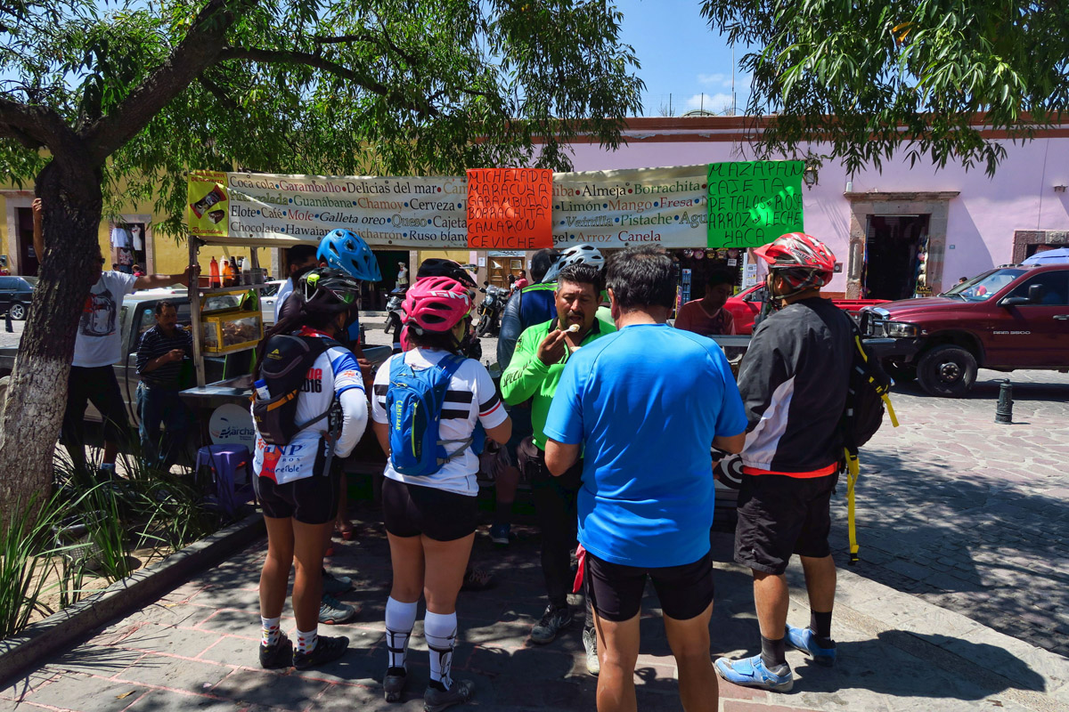 Local bike club stops at one of the more crowded ice cream carts.