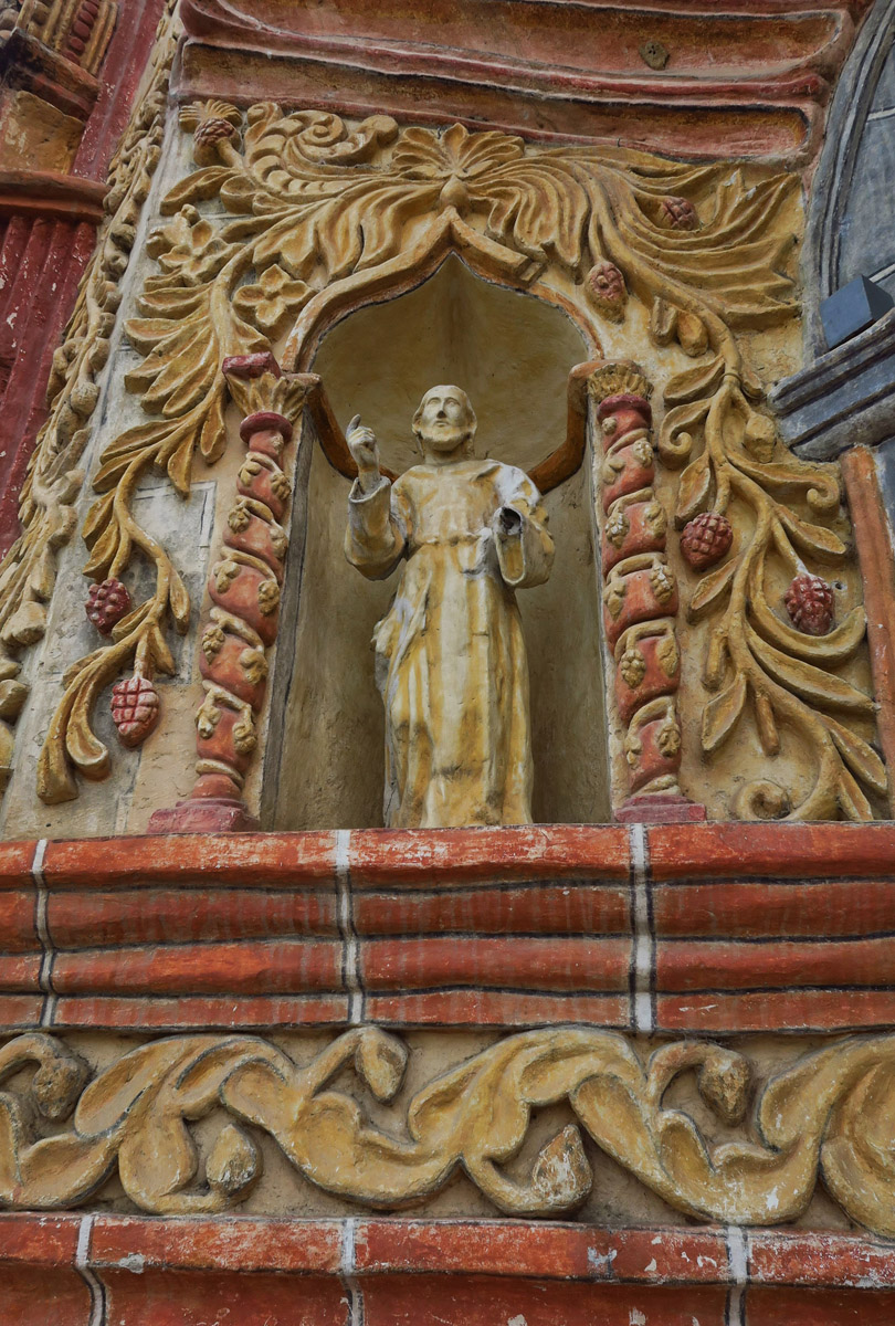 One of the rare saint statues who's head remains intact.