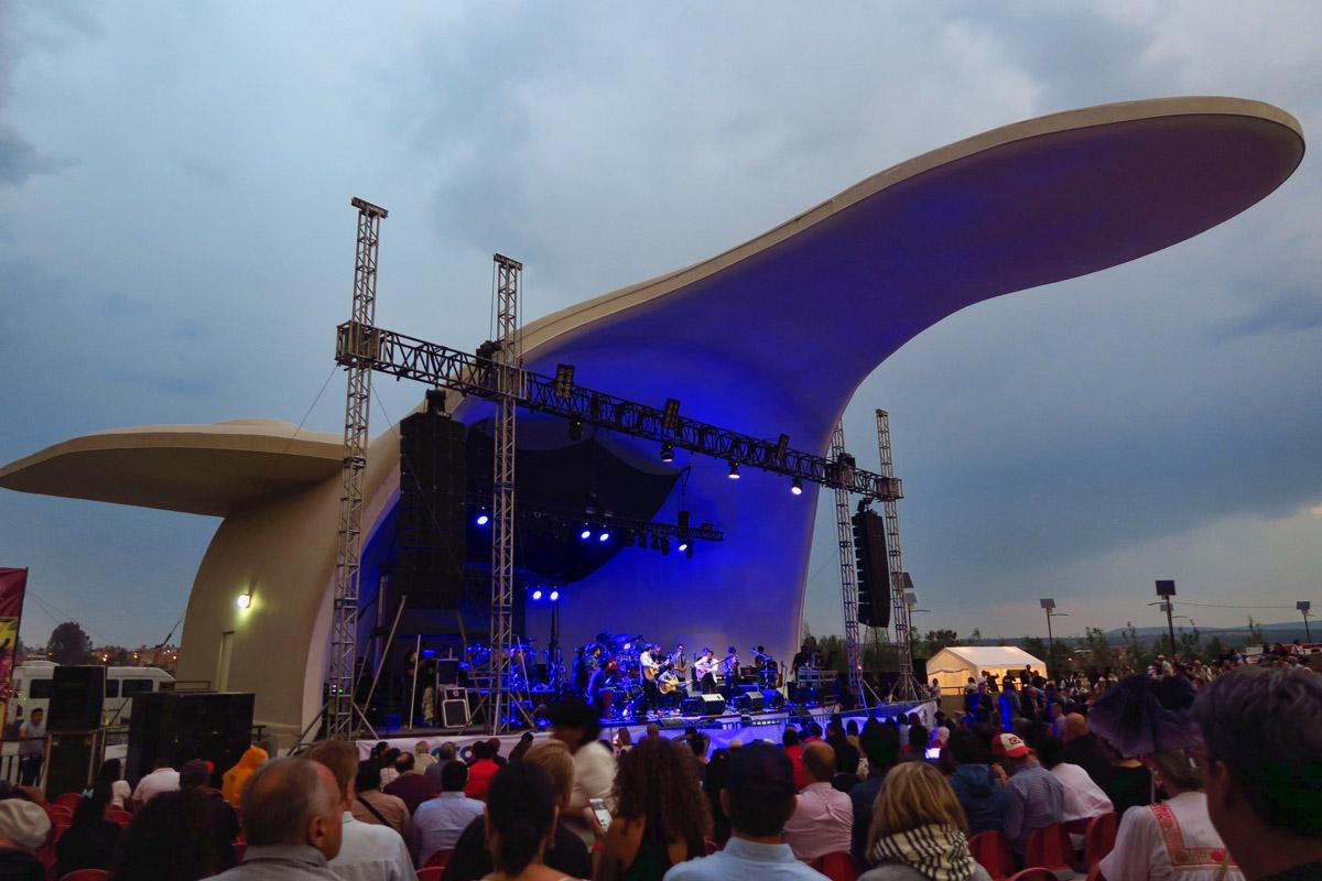 Concert ramps up under darkening skies.