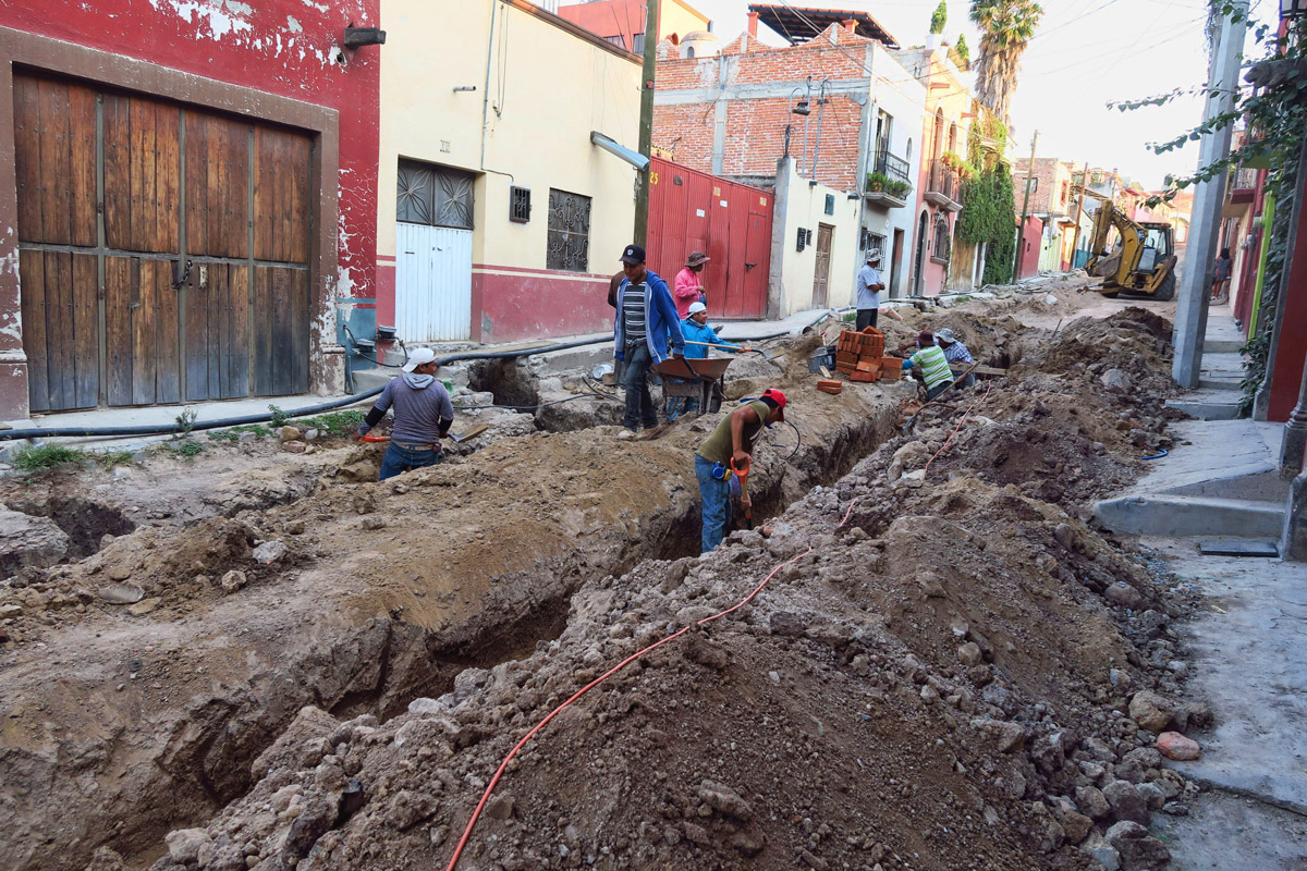 "Many of San Miguel's cobblestone streets are too narrow for heavy equipment, so roads are ""hecho a mano."""