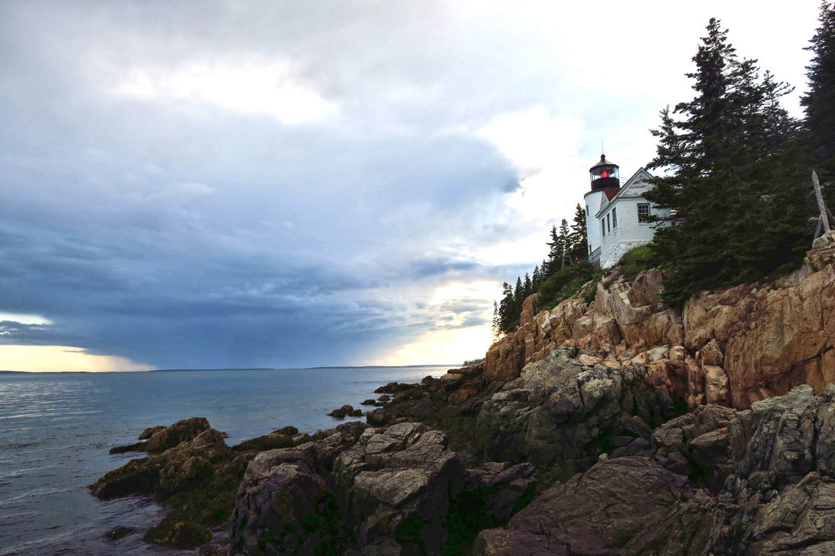 Acadia's Bass Harbor Head Light, built in 1858, automated in 1974. Has Fourth Order Fresnel lens covered by a red acrylic shroud. Signature 4 secs on/off.