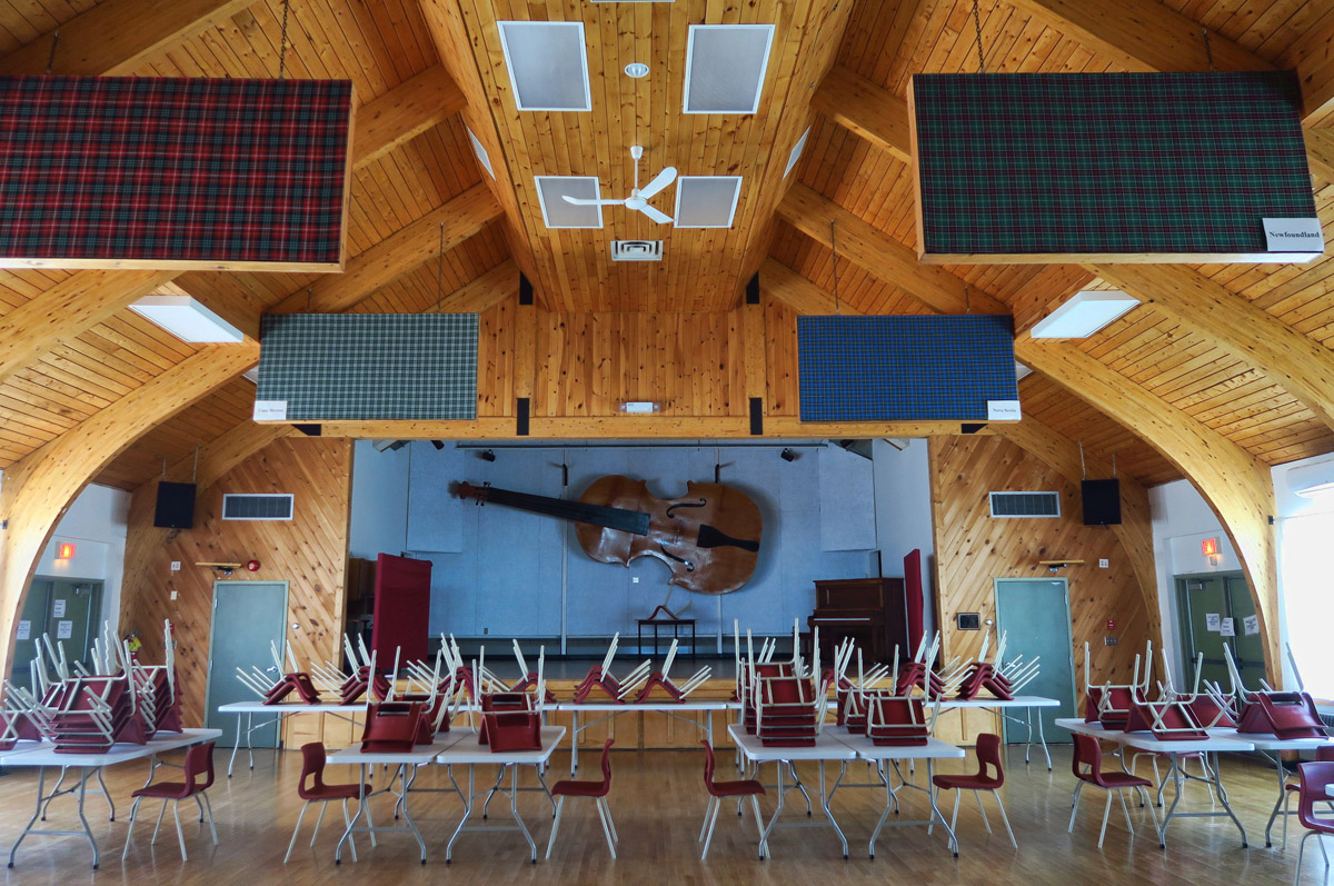 "The little hamlet of Judique has a beautiful venue for musical events. Notice the large examples of local ""tartan"" plaids hanging overhead."