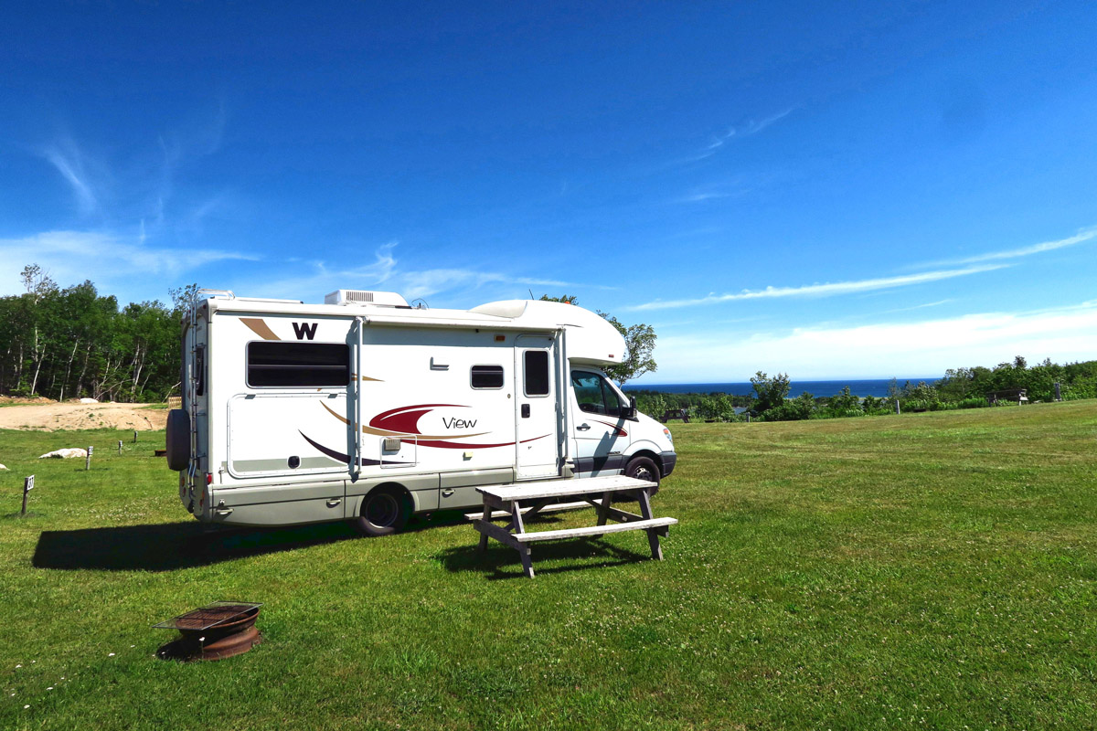 "I am finding campgrounds offer ""non-service"" sites, or dry camping, which is typically ""pull up on the grass until you get level and park it."""