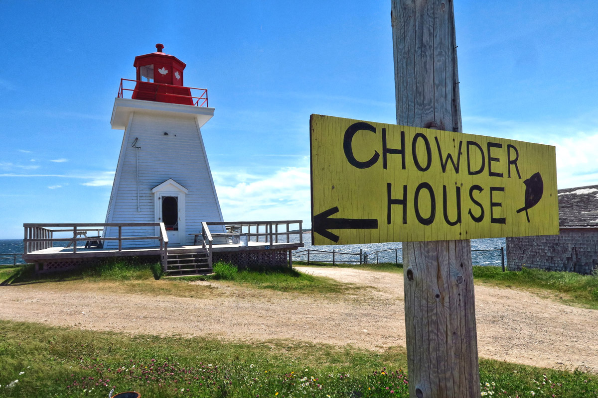 """Neil's Harbor Lightouse. Kinda shocking to see an """"Open"""" sign in the door, think you are walking into a lighthouse, and turns out it's an ice cream shop! They don't take their lighthouses as seriously as we do. ;-)"""