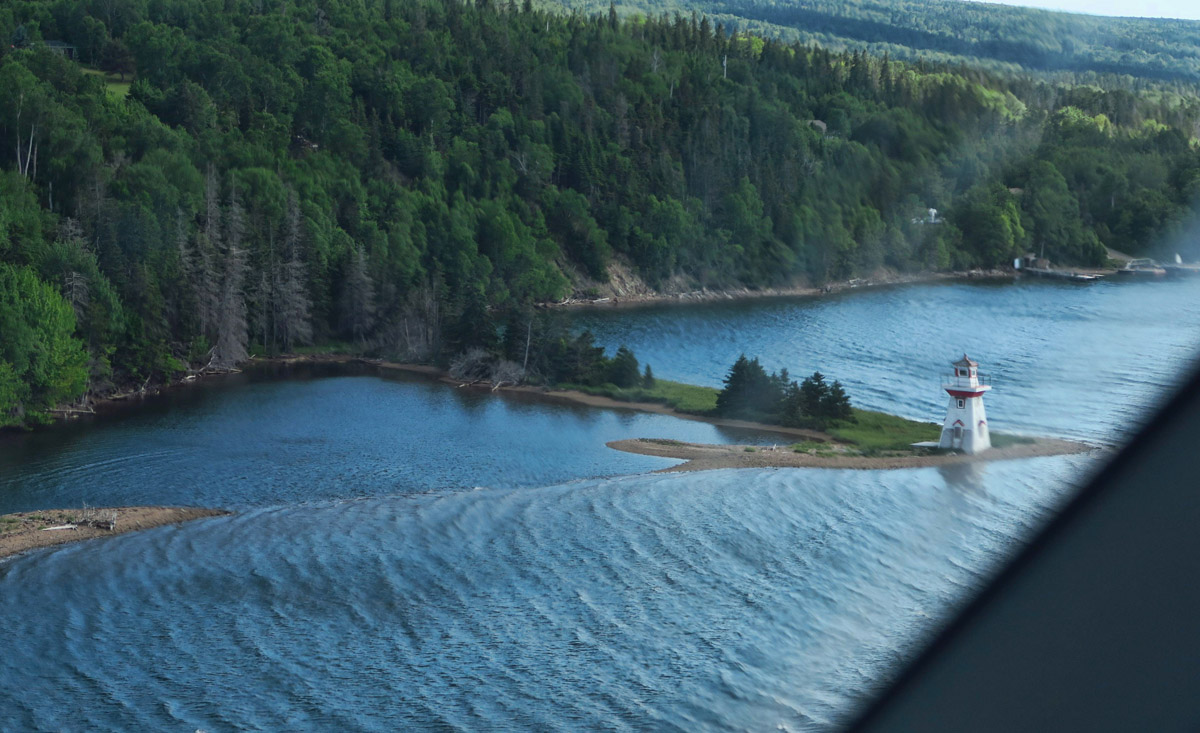 This is a terrible pic snapped out the passenger side window, but I could not resist the tiny lighthouse on the little promontory jutting out in the river!