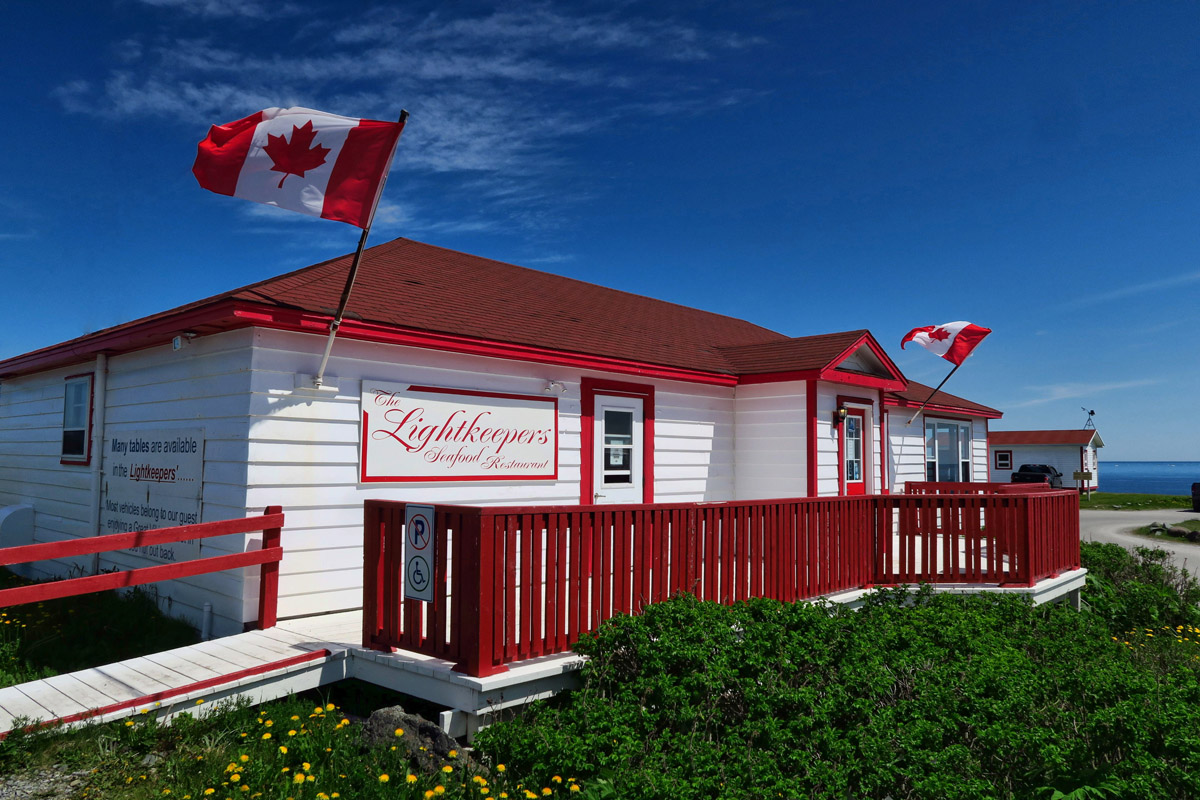 "The Lightkeeper's house has been converted to the best restaurant in town, ""Lightkeepers."""
