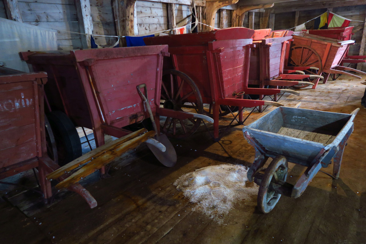 "Here, we are in the ""Salt Store."" These giant carts were used to transport salt to the ""stages"" where split, cleaned cod fish were salted to prepare for drying."