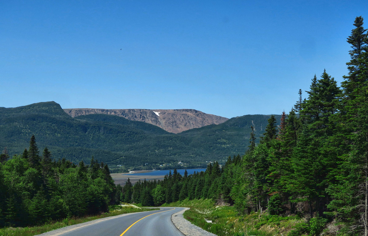Approaching the little fishing village of Trout River, the Tablelands begin to come into view.
