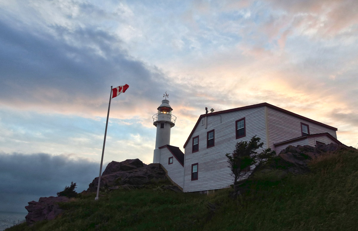 Lobster Cove Head Lighthouse, first a signal station (signal flags) in 1898, then 5th order lens, now automated and part of the Gros Morne NPS.