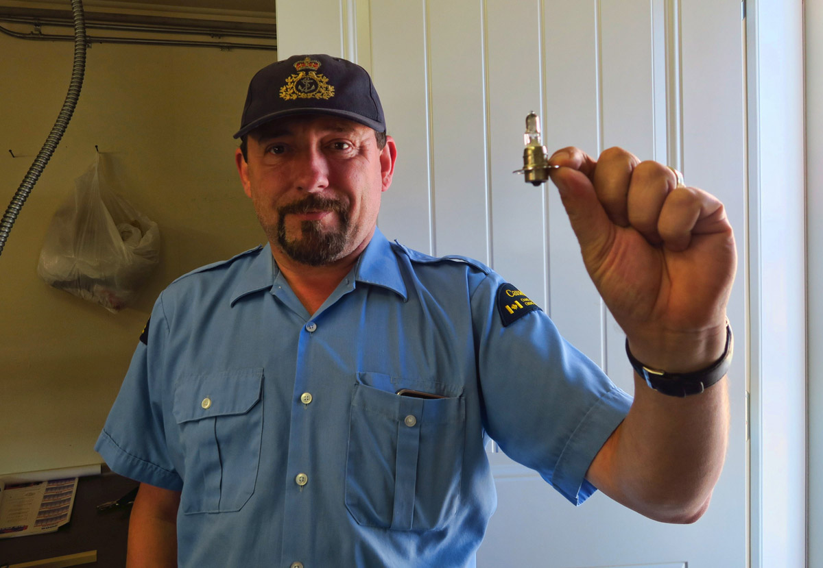 "This is Glenn. He is the official Coast Guard lightkeeper today. He gives me a tour of his ""office,"" and tells some interesting stories about being the lightkeeper here in the winter. This is the bulb that now powers the current lightstation."