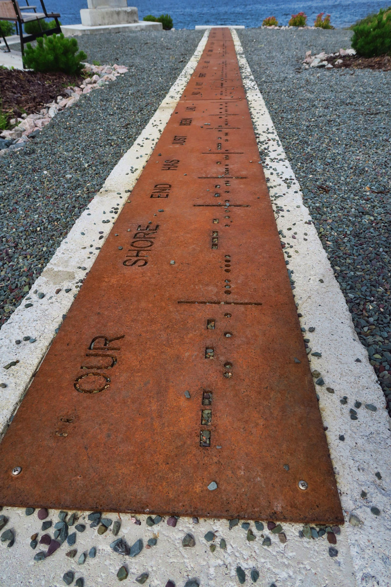 """This stretch of sidewalk at the memorial says, """"Our shore end has just been laid, and a most perfect cable under God's blessing has completed telegraphic communication between Ireland and the continent of America."""""""