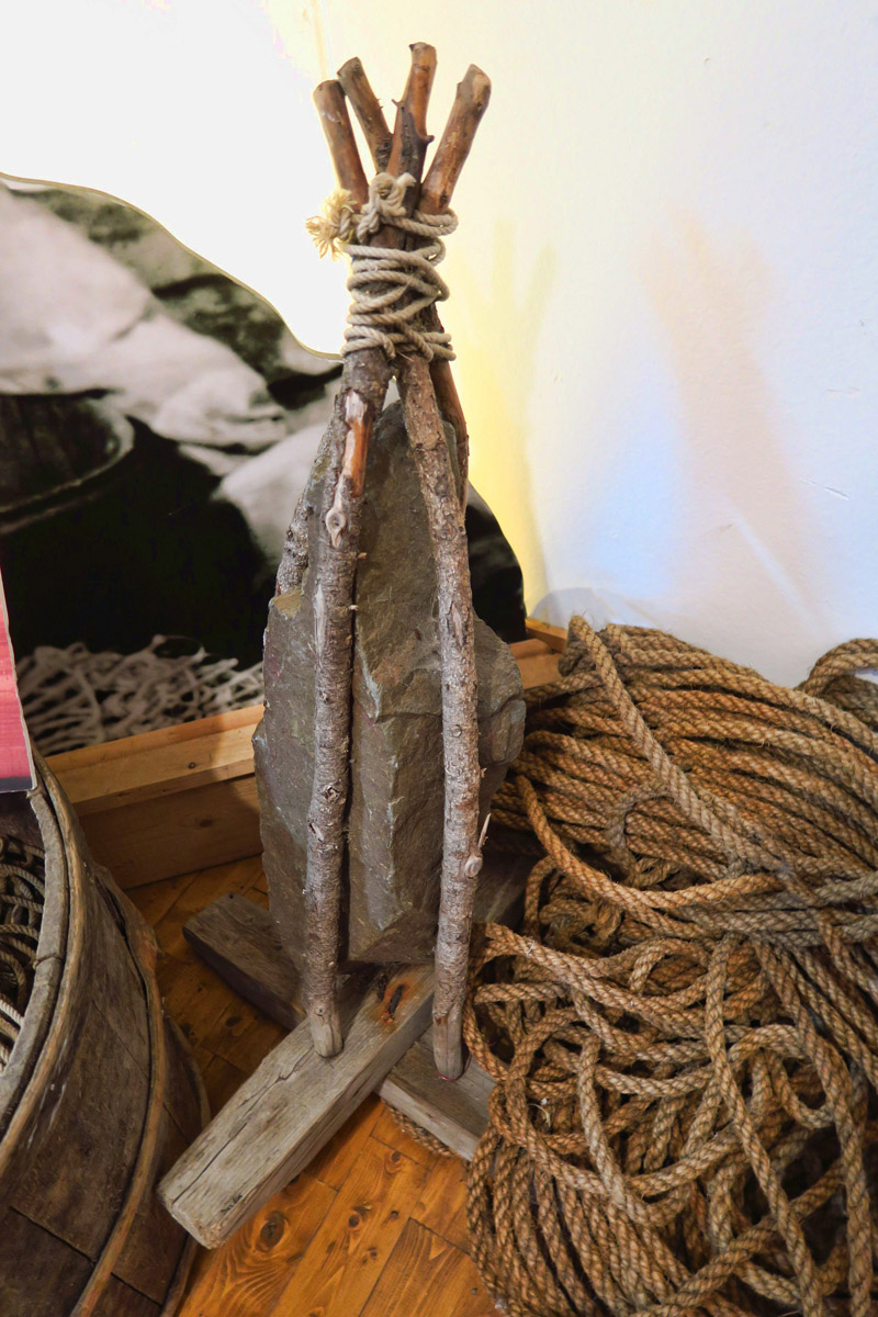 "A ""killick,"" or handmade anchor using rocks and sticks, common in Newfoundland."