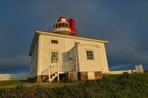 This style of wooden house around stone tower is similar to Cape Bonavista Lighthouse.