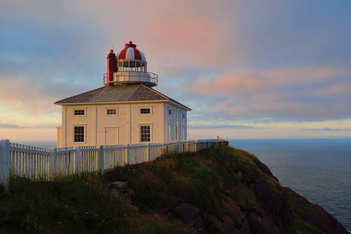 The only difference in the two is Cape Bonavista's wooden structure is red and white striped, while Cape Spear is solid white.