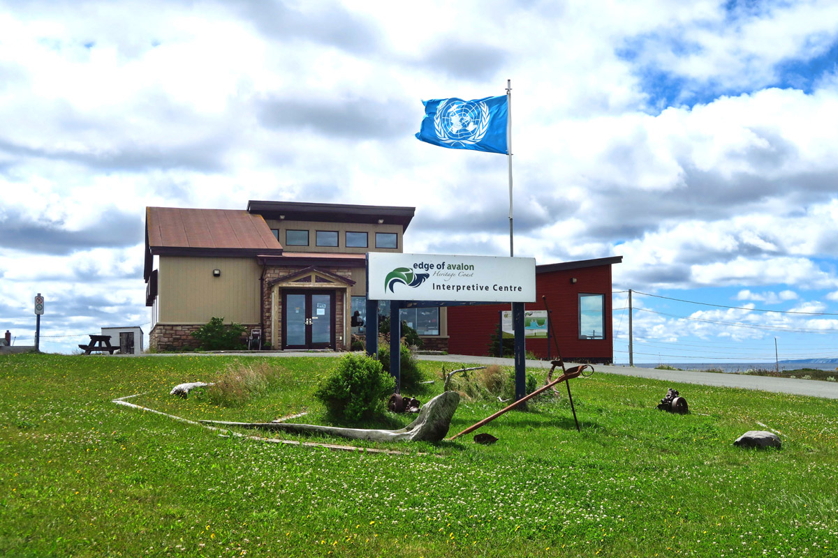 Edge of Avalon Interpretive Center, flying UNESCO World Heritage flag.