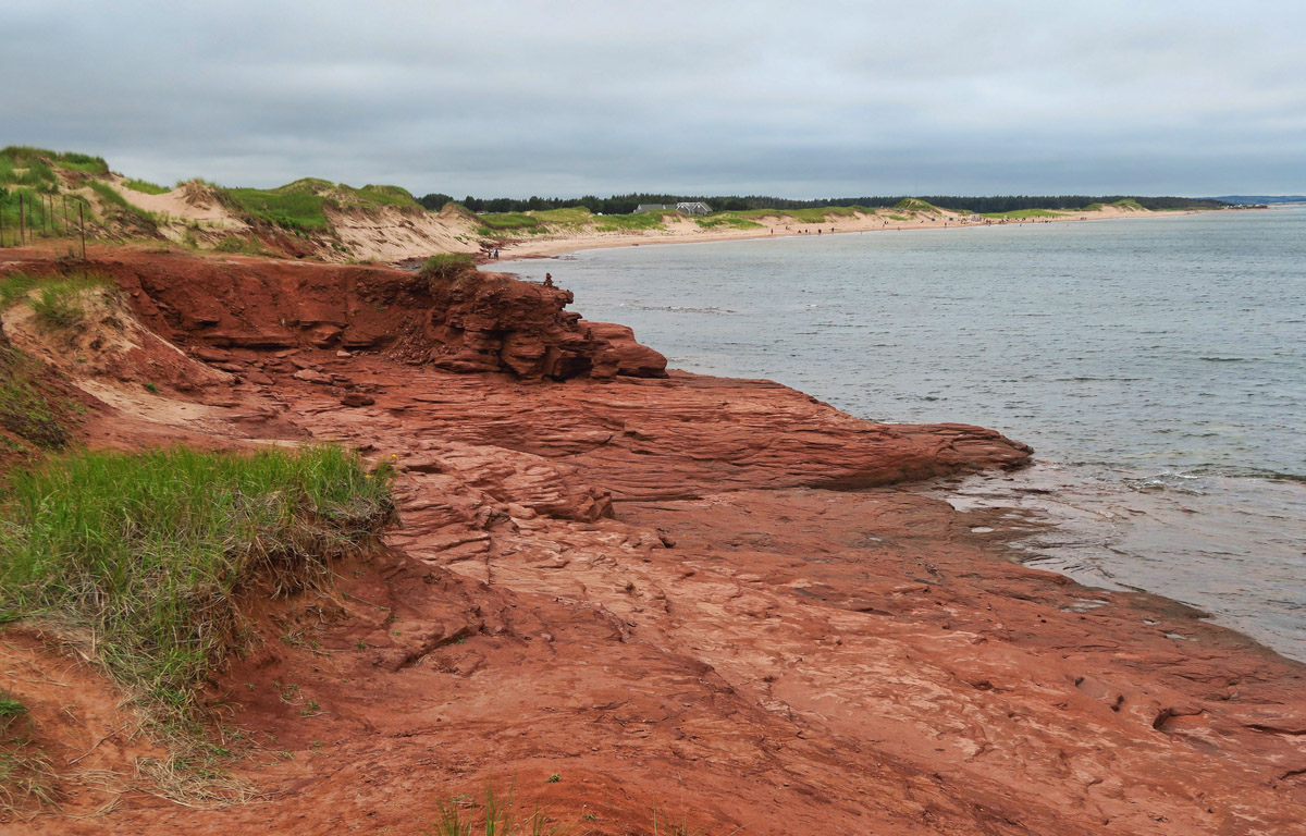 PEi is also known for both white and red sand beaches. Here you can see both, with white in the background and red in foreground.