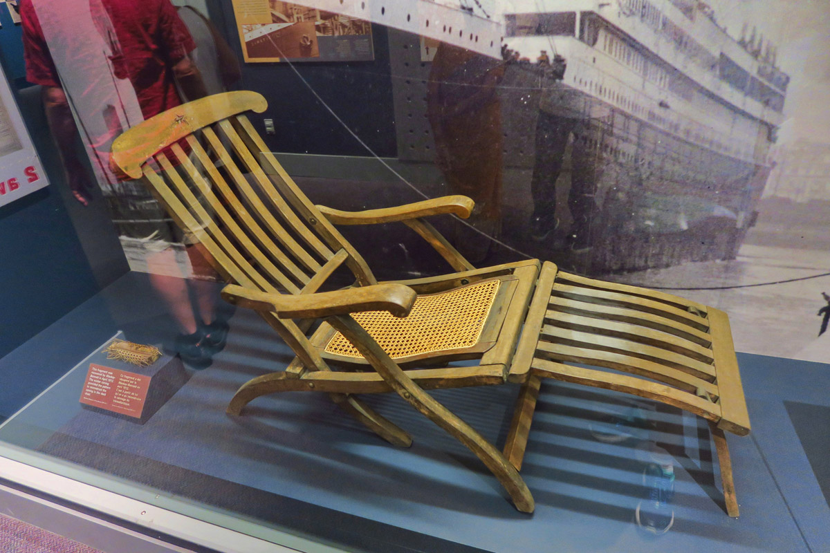 "One of the more famous artifacts, an original deck chair. How many times in my corporate career did I use the metaphor, ""Rearranging the deck chairs on the Titanic."" They have a replica just outside the glass that you can sit in..."