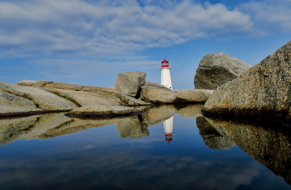 This famous icon is purported to be the most photographed lighthouse in all of Canada. Its image appears on the 25 cent coin.