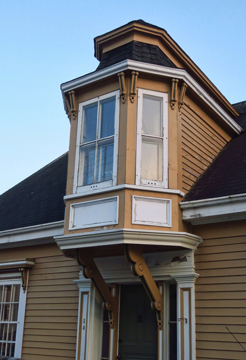 "Lunenburg architecture is known for the ""Lunenburg Bump"" where wives of captains are said to have looked out for the return of their men's boats from dormers protruding over the doorways of their houses."