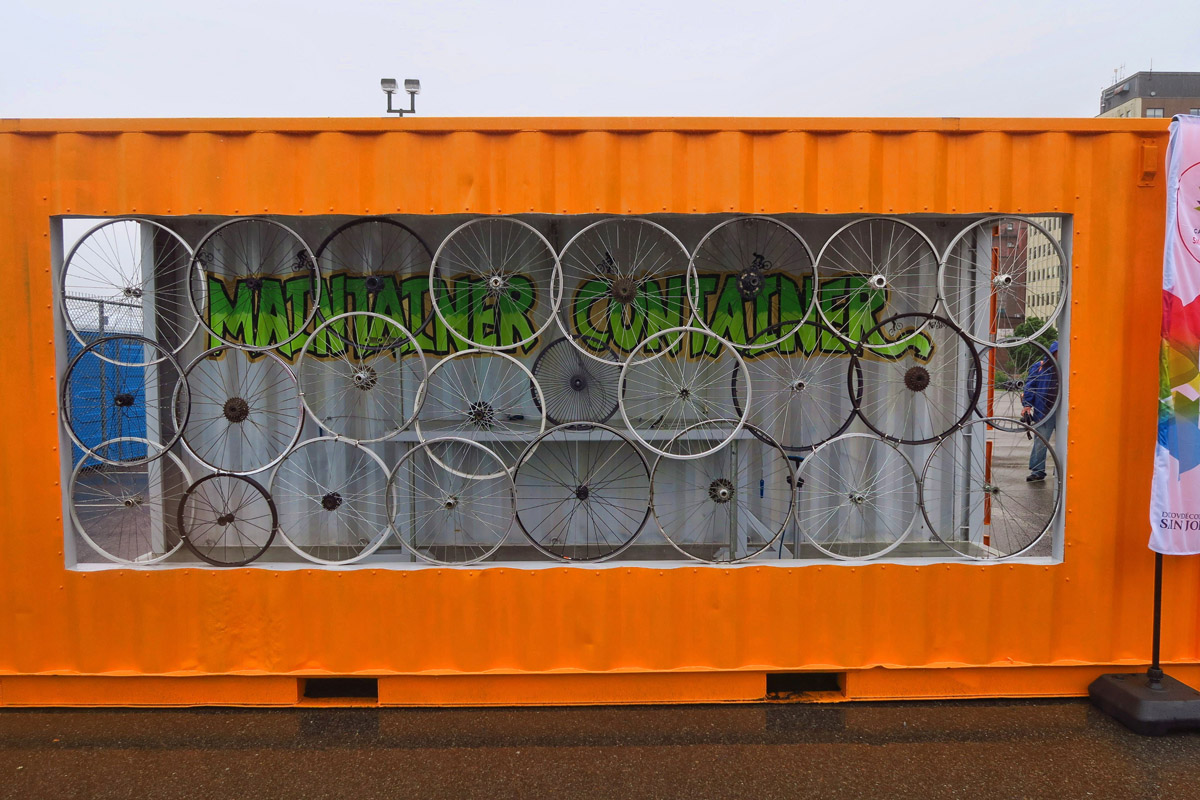 "At the entrance to the festival is the ""Maintainer Container,"" a bike maintenance stop in an old container, with tools and air pump for bike maintenance."