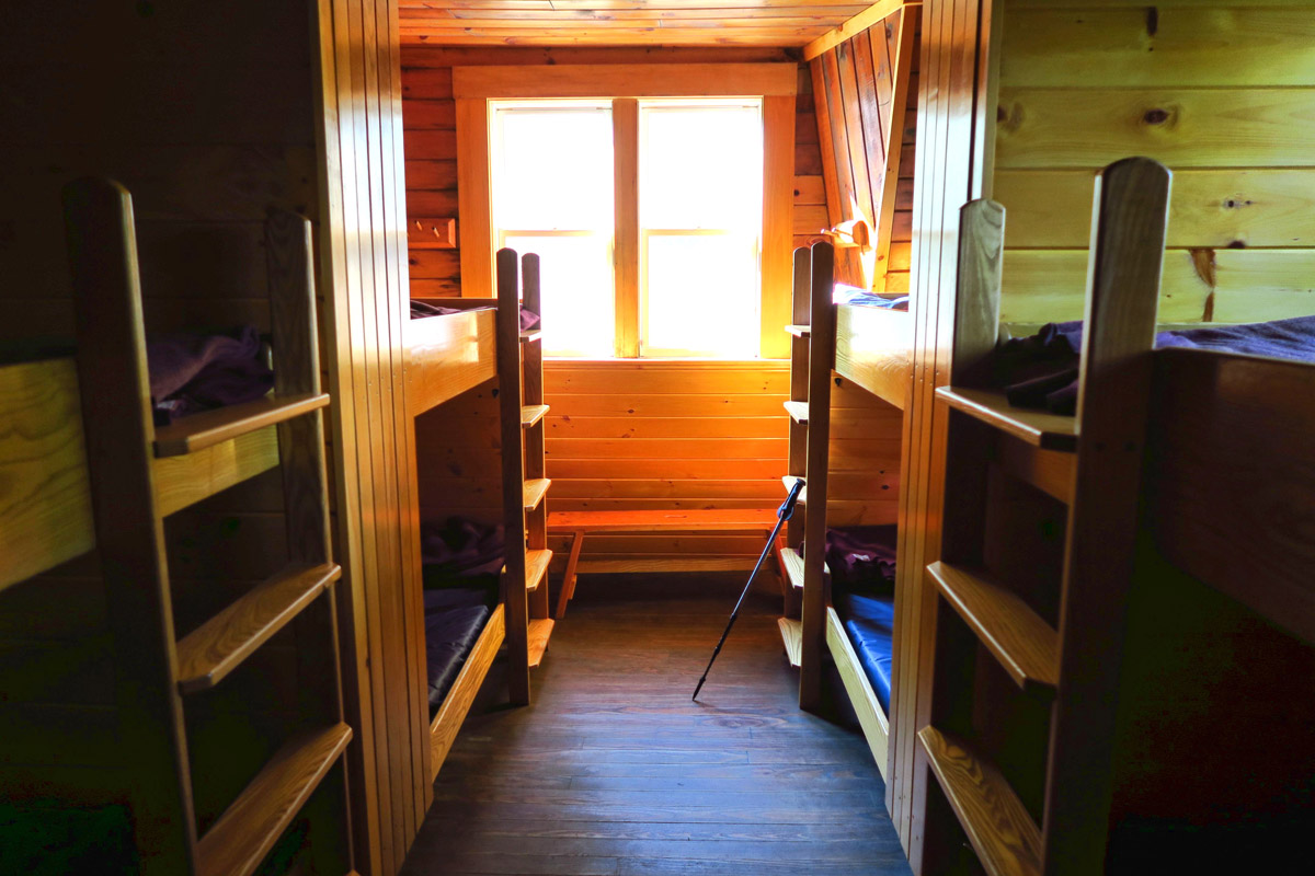Mitzpah Springs Hut sleeps 60 in several different bunk rooms. Mattress, pillow, and three wool blankets are provided. Hikers BYO sleeping bags.