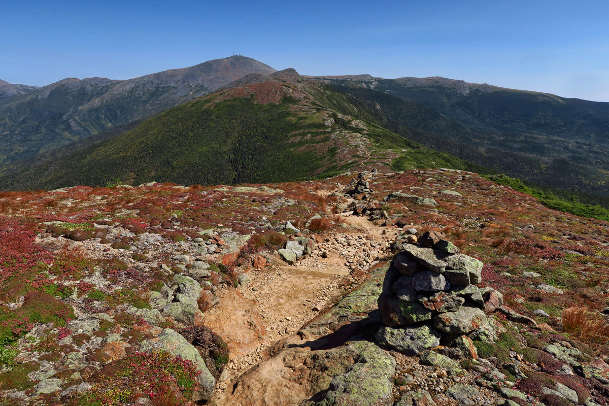 The trail between Mitzpah and the next hut, Lake of the Clouds, crosses four summits in the Presidential Range; Pierce, Eisenhower, Franklin, and Monroe. In the distance is the highest of the Presidential Range, Mt. Washington, at 6,288'.