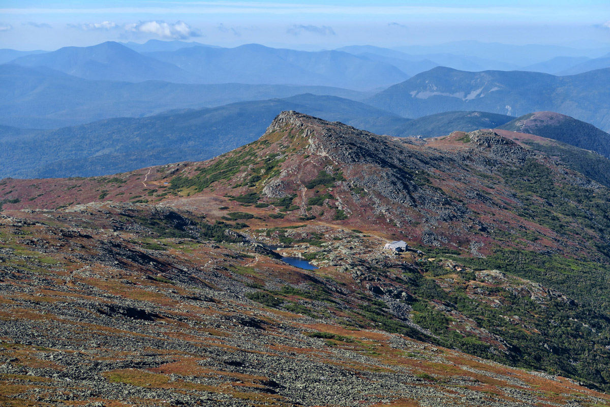 Looking back down on Lakes of the Clouds hut, with Mt Monroe in the background.
