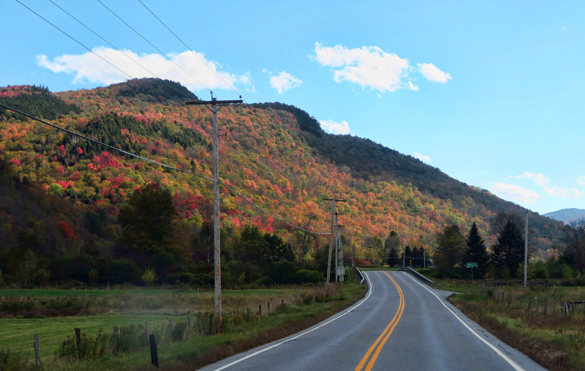 The hillsides are still not exactly a riot of color, but more so than northern Vermont.