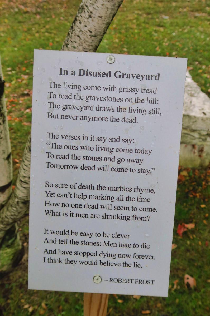 Frost poem is displayed alongside grave site.