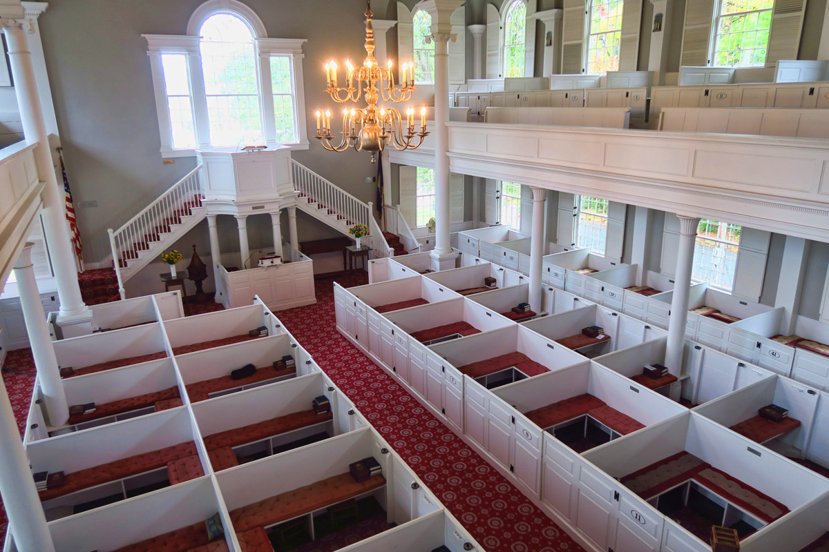 "Inside the sanctuary are ""box pews,"" which were sold to townspeople. Families would sit together in the boxes which protected from drafts in the cold New England winters."