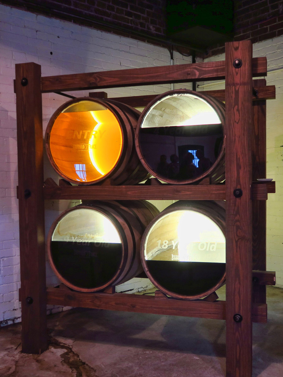"This display shows what happens to bourbon in the barrels upon entry, after four years, nine years, and eighteen years of evaporation. The alcohol emitted into the air is called the ""Angel's Share."""